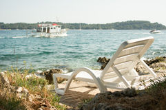 Lounger by the sea Royalty Free Stock Image