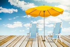 Loungers и зонтик Солнця Стоковое фото RF
