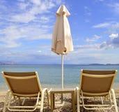 Loungers солнца пляжа Ipsos Стоковая Фотография