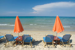 Loungers on the beach Stock Photography