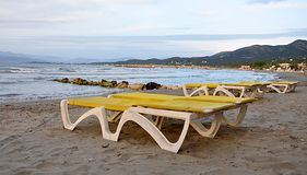 Loungers on the beach. Free beach chairs by the sea Stock Photo
