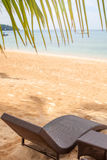 Loungers on beach. Nature vacation background royalty free stock image