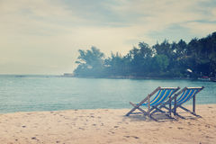 Loungers on the beach, with a retro image toning Royalty Free Stock Photos