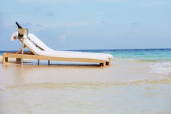 Loungers At Edge Of Tropical Sea With Champagne Bucket Royalty Free Stock Photos