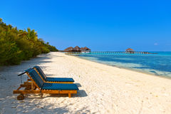 Loungers on Maldives beach Royalty Free Stock Photo