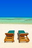 Loungers on Maldives beach Stock Photos