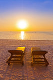 Loungers on Maldives beach Royalty Free Stock Images