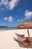 Loungers and parasol  on a tropical beach, Isle of Pines Stock Photos