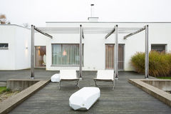 Loungers at the patio. Horizontal view of loungers at the patio Royalty Free Stock Photo