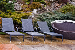 Loungers by the pool. Loungers rattan by the pool stock photo