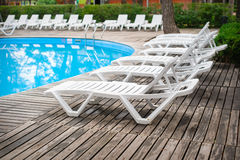 Loungers by the pool at the recreation center Stock Photos