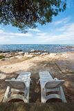Loungers on the rocky beaches Royalty Free Stock Photos