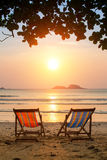 Loungers on the Sea beach at amazing sunrise. Nature. Loungers on the Sea beach at amazing sunrise Royalty Free Stock Images