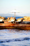 Loungers and sea.jpg Stock Image