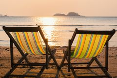 Loungers at the seaside at sunset. Nature. Loungers at the seaside at sunset royalty free stock photos