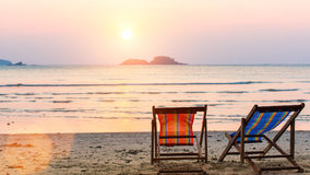 Loungers at the seaside at sunset. Nature. Loungers at the seaside at sunset Stock Photos