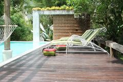 Loungers by the side of  swimming pool. Of the hotel resort Royalty Free Stock Images