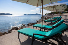 Loungers and sunshades at the beach Royalty Free Stock Photo