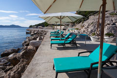 Loungers and sunshades at the beach Stock Photo