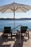 Loungers and sunshades at the beach Stock Photography