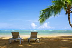 Two beach lounge on a beautiful tropical beach . royalty free stock photography