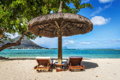 Loungers and umbrella on tropical beach in Mauritius. Island, Indian Ocean Stock Photo