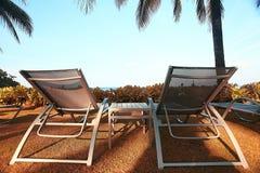 lounges at sandy beach Stock Photos