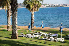Lounges and umbrellas on sea beach Royalty Free Stock Photos