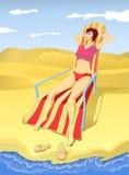 Lounging en la playa Foto de archivo