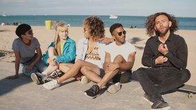 Lounging young friends on city coastline stock video