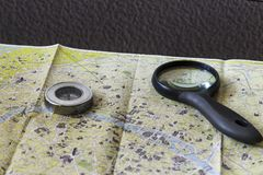 Loupe and compass on the map of Paris. Travel, tourism. Loupe and compass on the map of Paris. Travel, tourism, guide Stock Images