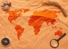 Loupe, compass and rope on old map Royalty Free Stock Photos