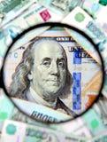 Loupe et un argent image stock