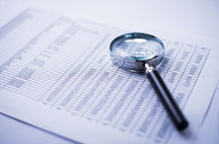 Loupe and the financial report Royalty Free Stock Photo
