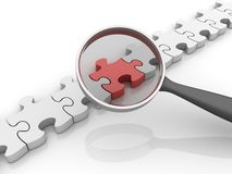 Loupe with Jigsaw Pieces Royalty Free Stock Photography