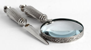 Loupe and Letter Opener Royalty Free Stock Photography