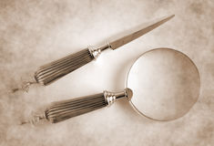 Loupe and Letter Opener Royalty Free Stock Images