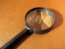 Loupe. Magnifier lying on the book Royalty Free Stock Images