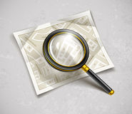 Loupe magnifying glass tool with streets paper map Stock Images
