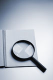 Loupe and notebook Royalty Free Stock Photo
