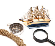 Loupe, rope, compass and model classic boat Stock Photos