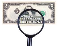 Loupe zooms banknote Royalty Free Stock Images