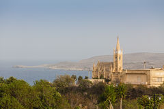 Lourdes Chapel. The Lourdes Chapel gothic church is dominating Ghajnsielem harbour, Gozo island, Malta Stock Photography