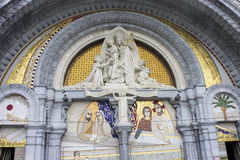 Lourdes, France. Details of the main door of the Sanctuary of Our Lady of Lourdes, a destination for pilgrimage in France Royalty Free Stock Images
