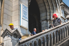 Tourists come out of the basilica of immaculate design down a st Stock Images