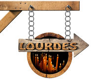 Lourdes - Wooden Sign with Votive Candles Royalty Free Stock Images