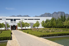 Lourensford winery in Somerset West South Africa. Lourensford Wine Estate winery a modern building overlooked by the Hottentot Holland mountains in Somerset West Royalty Free Stock Photo
