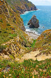 The Lourical beach among the rocks of Cabo da Roca Stock Images