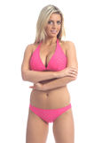 Louro no biquini cor-de-rosa fotografia de stock