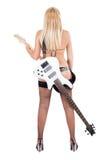 Louro sexual e uma guitarra baixa branca Fotografia de Stock